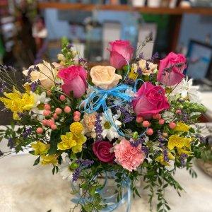 Centro orquidea y rosas rojas Vidar